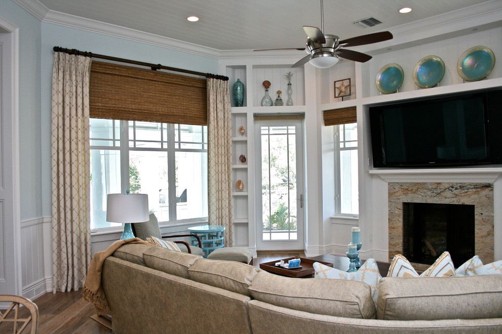 Family room - beach style family room idea in Tampa with blue walls