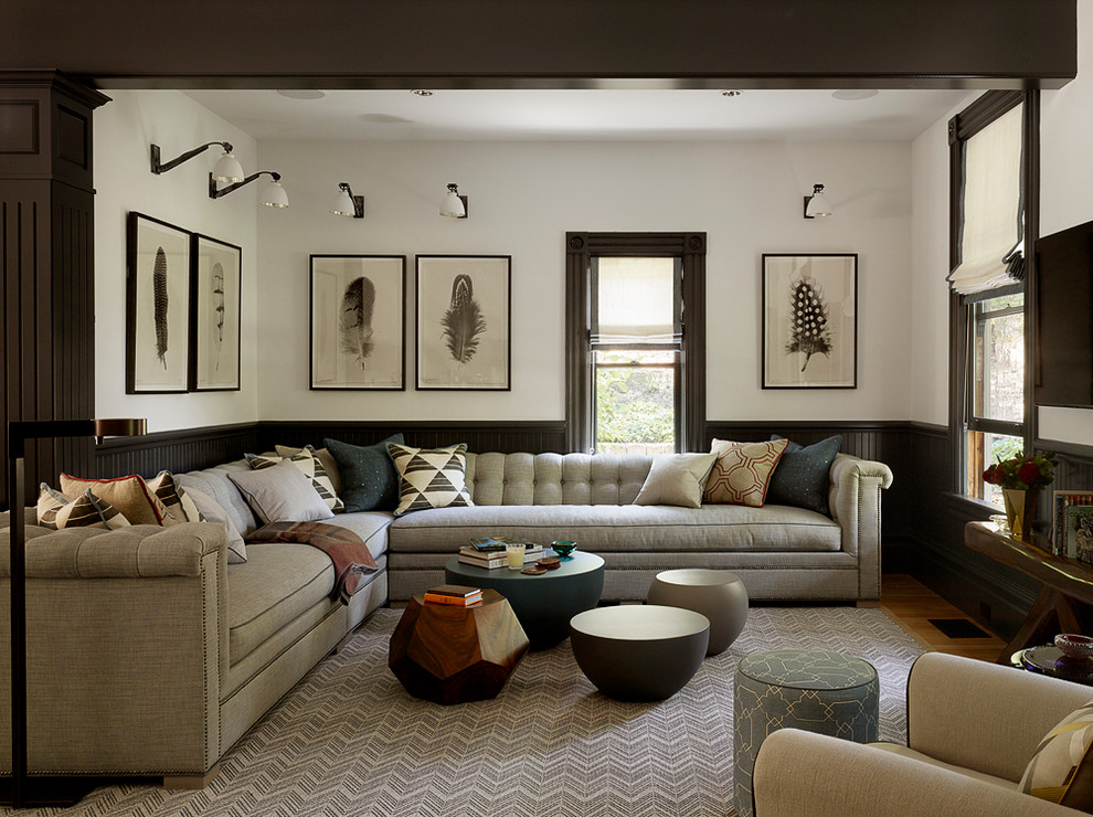 Inspiration for a transitional medium tone wood floor family room remodel in San Francisco with white walls