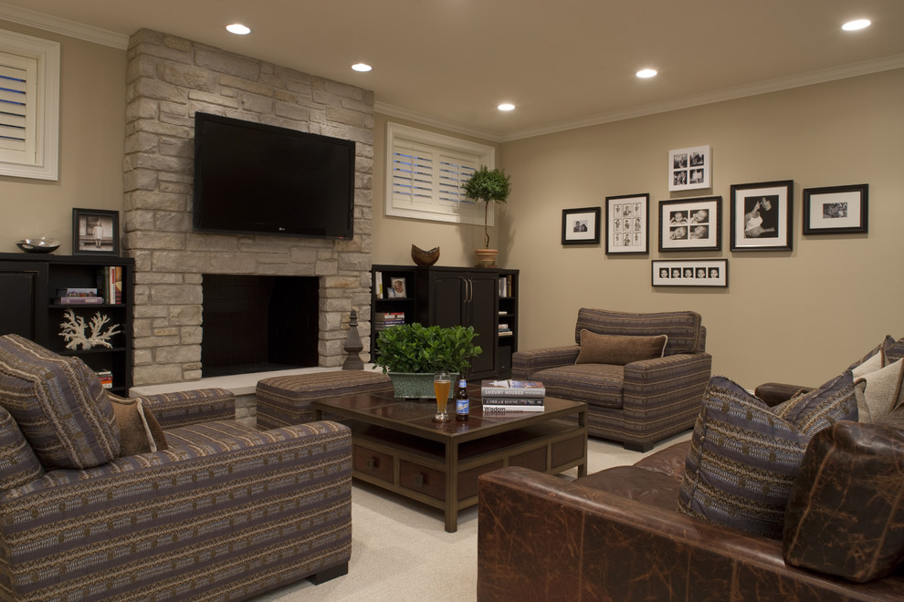 Inspiration for a contemporary enclosed carpeted family room remodel in Chicago with beige walls, a standard fireplace, a stone fireplace and a wall-mounted tv