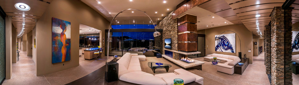 Example of a large trendy open concept concrete floor family room design in Phoenix with beige walls and a wall-mounted tv