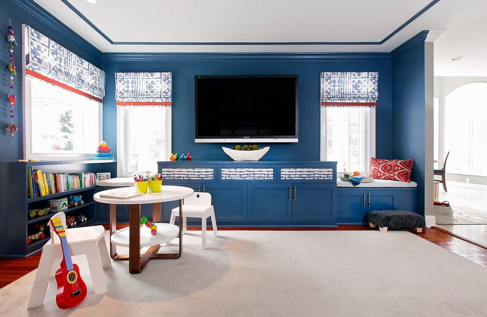 Inspiration for a mid-sized modern enclosed carpeted family room remodel in New York with blue walls, a standard fireplace, a stone fireplace and a wall-mounted tv