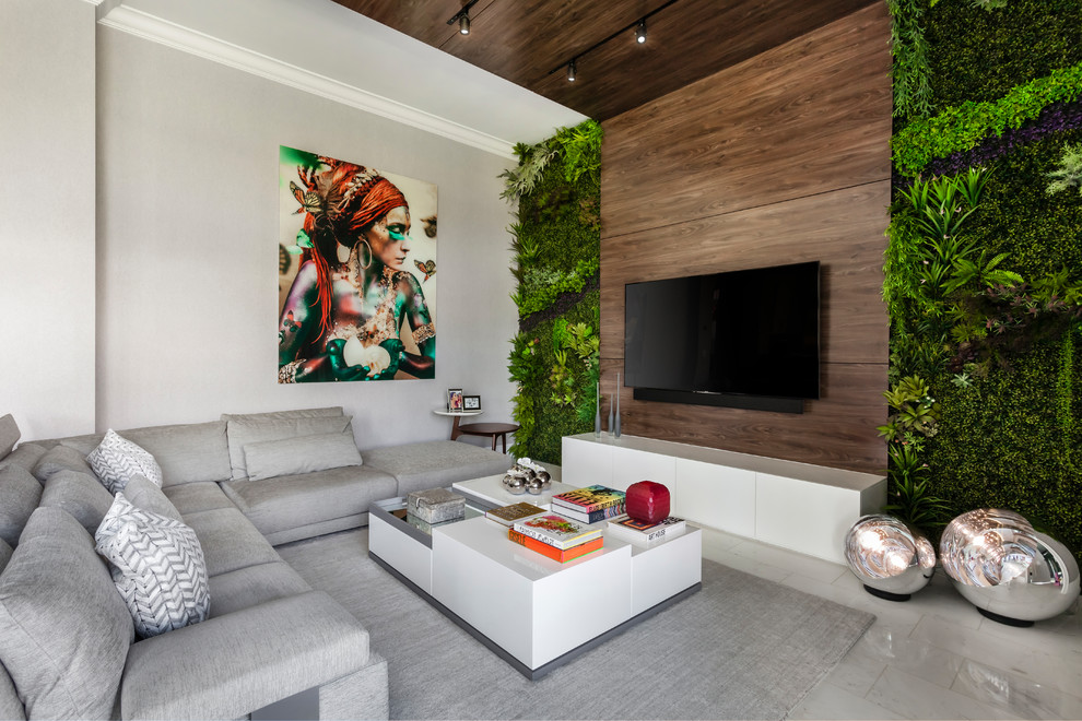 Family room - contemporary gray floor family room idea in Miami with white walls and a wall-mounted tv