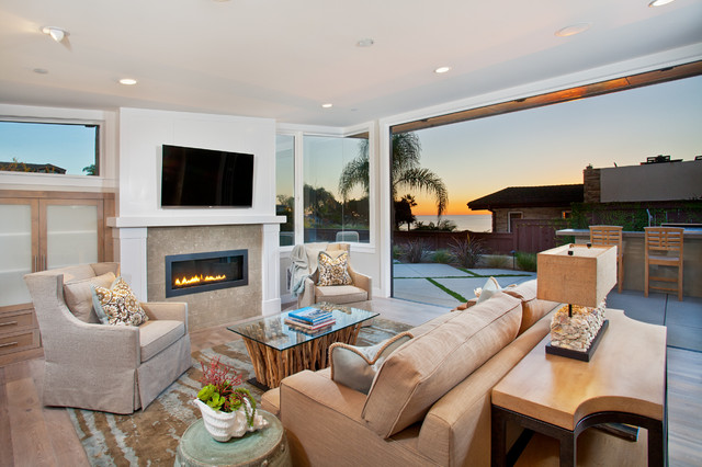 Inspiration for a contemporary open concept family room remodel in San Diego with white walls, a ribbon fireplace and a wall-mounted tv