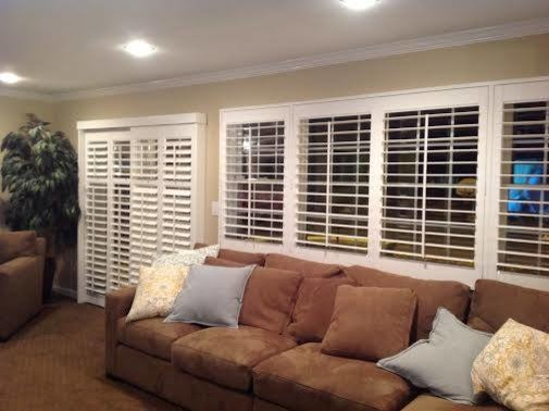 shutters on a slider and living room window - modern - family room