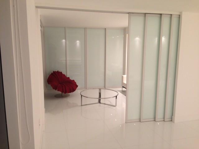 sliding doors contemporary family room miami by metro door usa. Black Bedroom Furniture Sets. Home Design Ideas