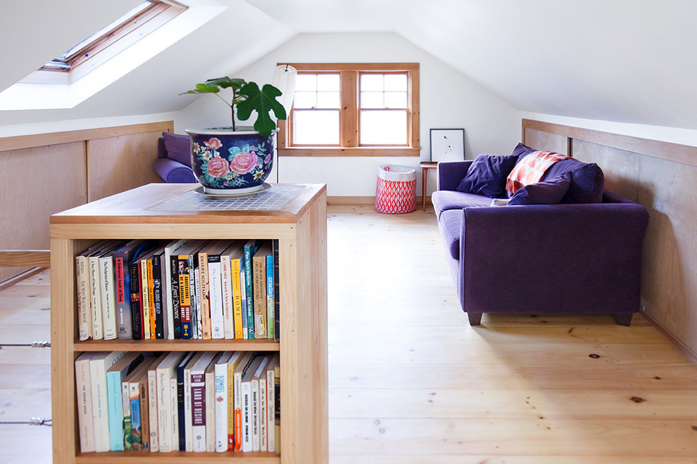 Inspiration for a small contemporary loft-style light wood floor and beige floor family room library remodel in Portland Maine with white walls, no tv and no fireplace