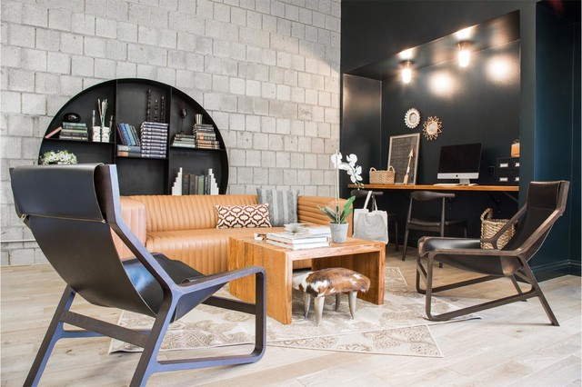 Inspiration for an industrial light wood floor family room remodel in Los Angeles with no fireplace and no tv