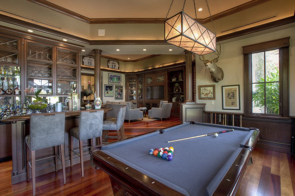 Elegant open concept dark wood floor family room photo in Miami with beige walls