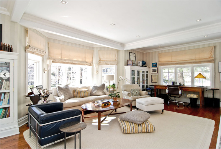 Example of a mid-sized transitional enclosed dark wood floor family room design in New York with no fireplace and a wall-mounted tv