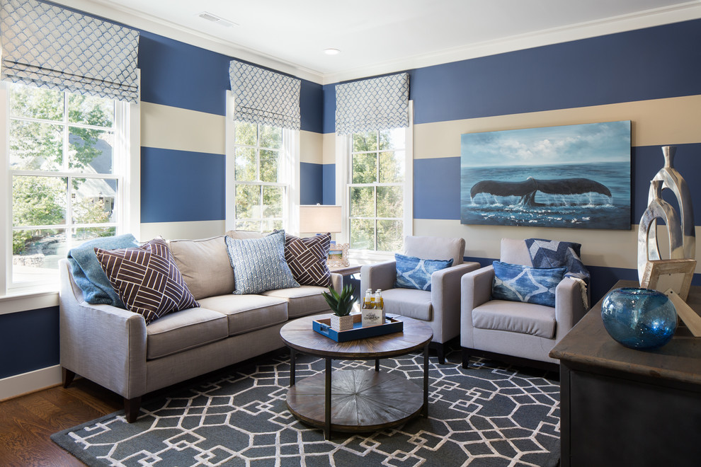Inspiration for a coastal dark wood floor and brown floor family room remodel in Birmingham with multicolored walls