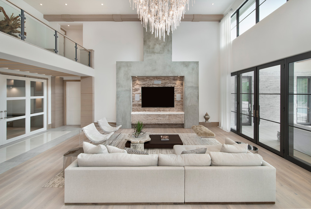 Trendy light wood floor family room photo in Miami with white walls, no fireplace and a wall-mounted tv