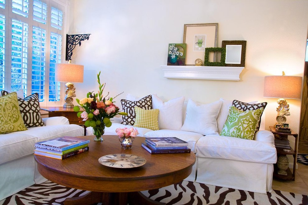 Elegant family room photo in Other with white walls