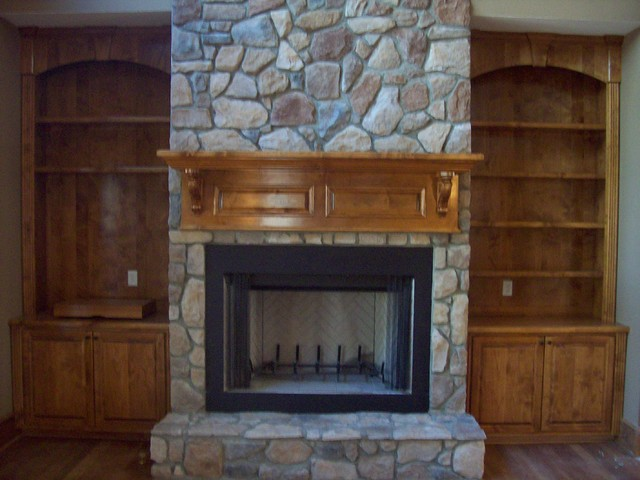 Stained Mantel On Stone Fireplace With Double Built Ins Rustic Family Room Raleigh By