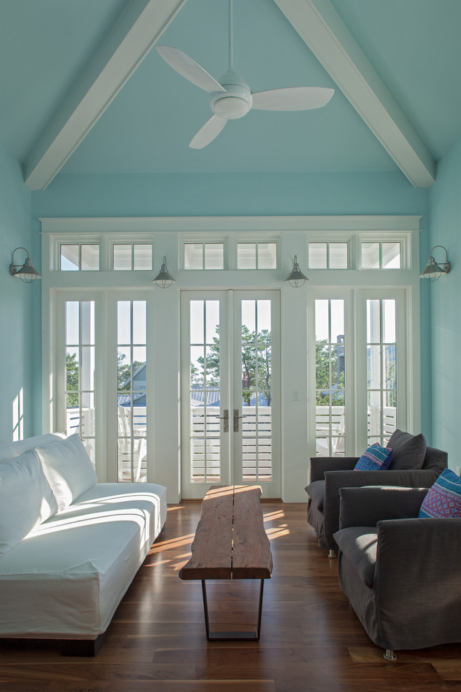 Inspiration for a contemporary family room remodel in Miami with blue walls