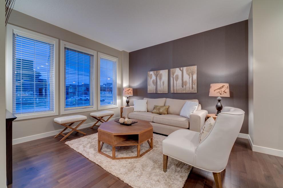 Family room - contemporary medium tone wood floor family room idea in Calgary with multicolored walls