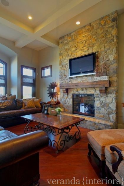 Stone fireplace w/ timber mantle  family room
