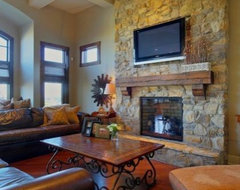 Stone fireplace w/ timber mantle family-room