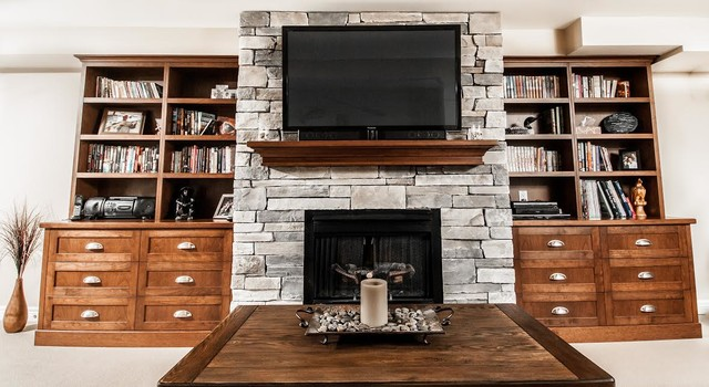 stone fireplace with cherry wall units