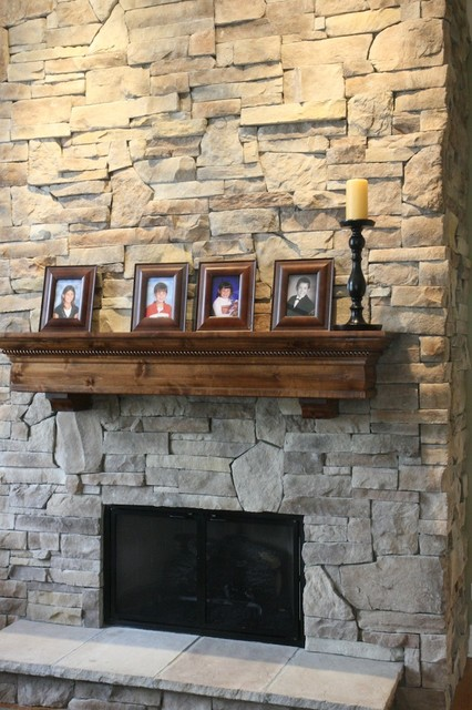Stone Fireplaces and Wood Mantels traditional-family-room