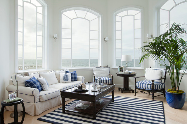Trendy light wood floor family room photo in Los Angeles with white walls