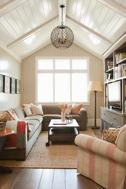 Family room - beach style dark wood floor family room idea in Los Angeles with beige walls