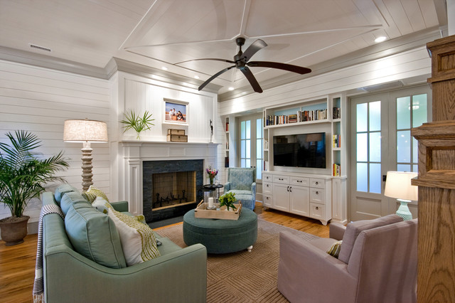 Superior Traditional Medium Tone Wood Floor Family Room Idea In Charleston With  White Walls, A Standard