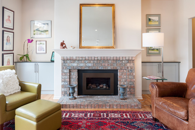 Mid-sized elegant open concept light wood floor family room photo in Seattle with a standard fireplace, a brick fireplace and no tv
