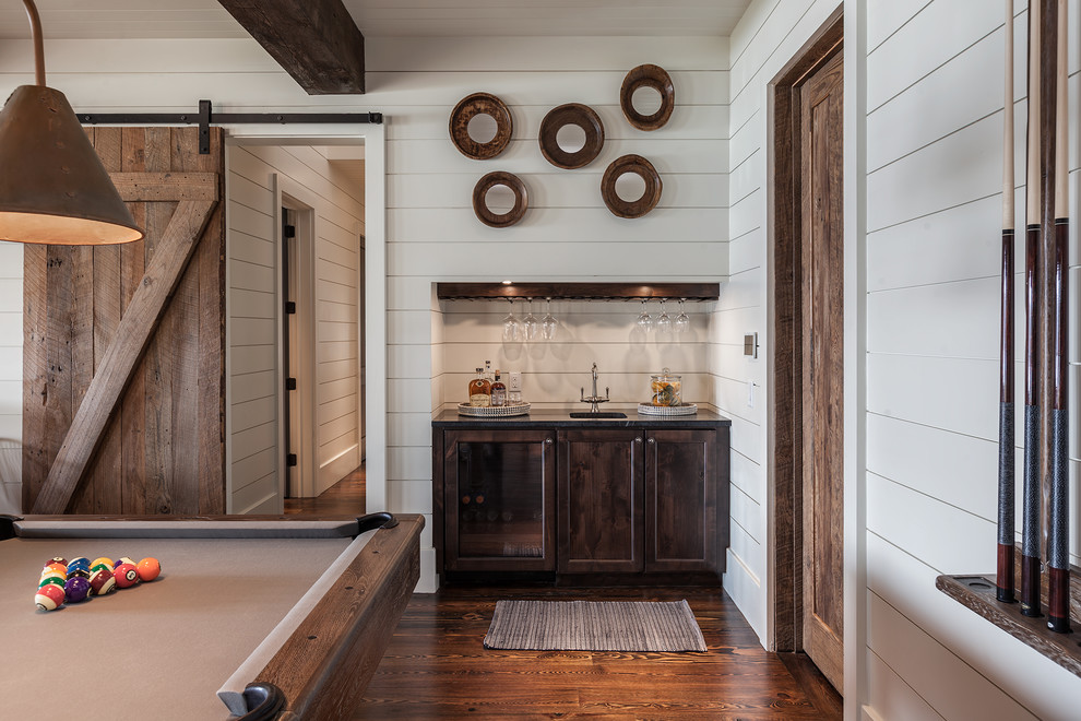Inspiration for a large cottage open concept dark wood floor and brown floor game room remodel in Other with white walls
