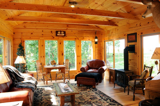 Sunroom rustic family room by jg development inc for Log cabin sunroom additions