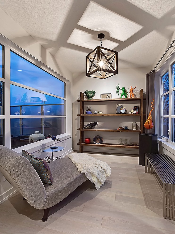 Inspiration for a small transitional family room library remodel in Calgary with no fireplace and no tv