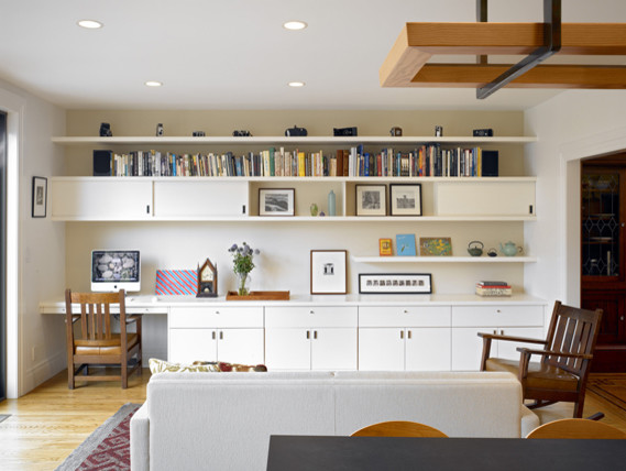 Mid-sized eclectic open concept light wood floor family room photo in San Francisco with white walls, no fireplace and no tv