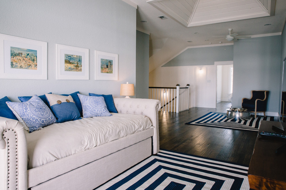 Mid-sized beach style open concept dark wood floor and brown floor family room photo in Dallas with blue walls, no fireplace and a tv stand
