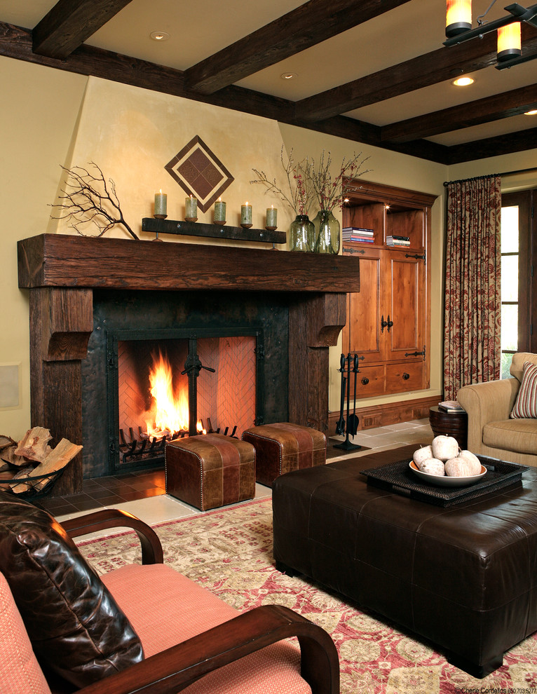 Inspiration for a rustic family room remodel in San Francisco with beige walls, a standard fireplace and a wood fireplace surround