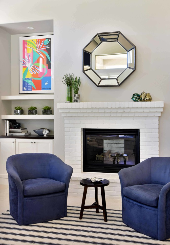 Inspiration for a mid-sized transitional open concept porcelain floor and beige floor family room remodel in Phoenix with beige walls, a standard fireplace, a brick fireplace and no tv