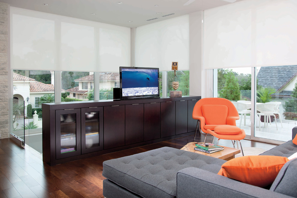 Trendy loft-style dark wood floor family room photo in Orlando with a tv stand