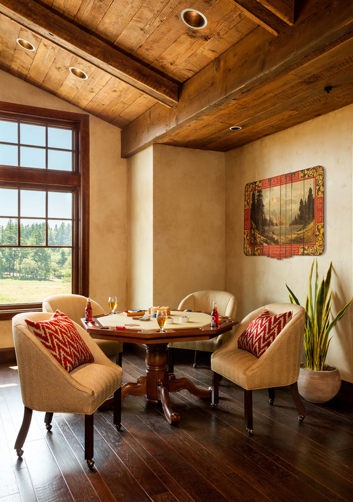 Example of a huge mountain style enclosed dark wood floor game room design in Portland with beige walls