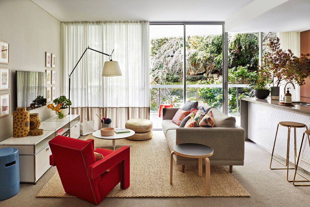 Family room - mid-sized contemporary open concept carpeted family room idea in Sydney with no fireplace, a wall-mounted tv and beige walls