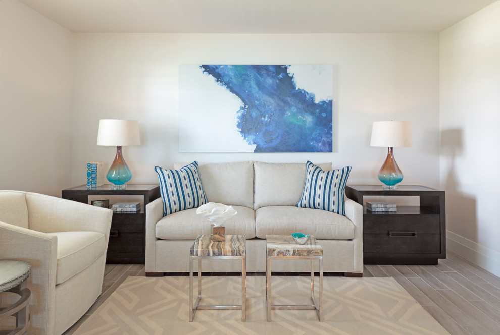 Inspiration for a small contemporary light wood floor family room remodel in Miami with gray walls