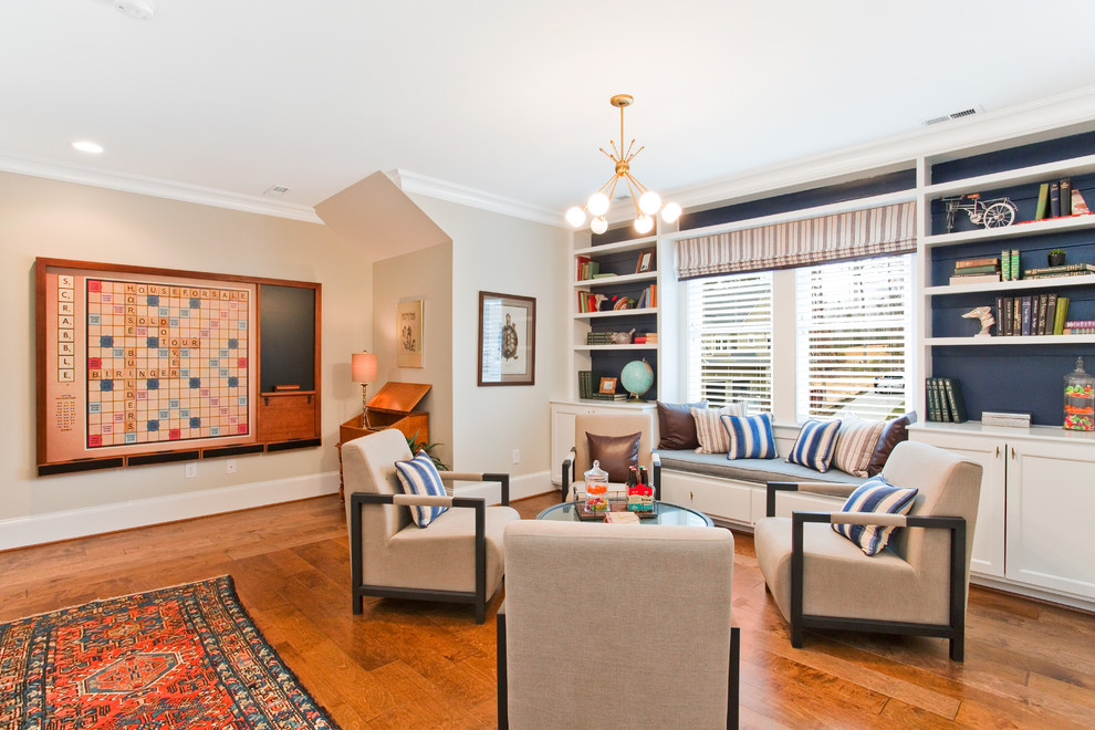 Example of a classic medium tone wood floor and brown floor family room design in Richmond with beige walls