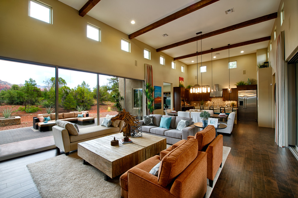 Family room - transitional open concept dark wood floor family room idea in Phoenix with beige walls