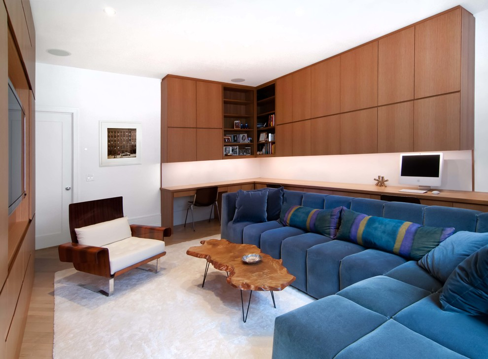 Example of a trendy enclosed medium tone wood floor family room design in New York with white walls