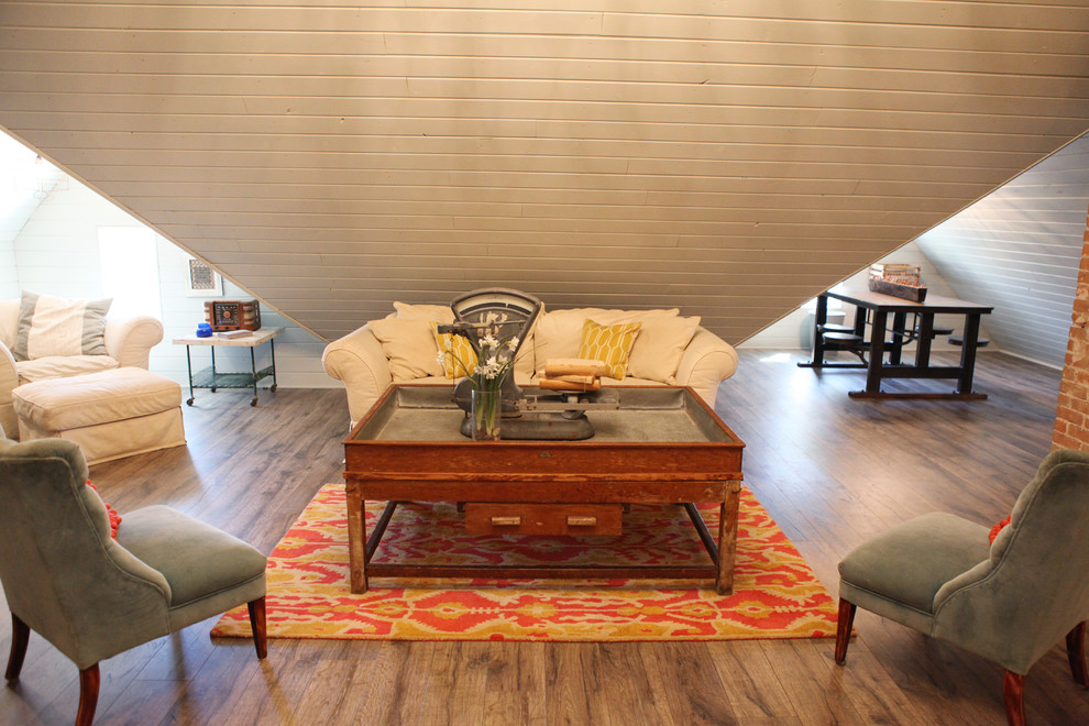 Example of a mid-sized cottage medium tone wood floor family room design in Austin with white walls