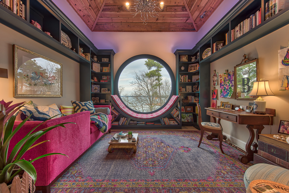 Example of a mid-sized eclectic blue floor family room library design in Other with beige walls