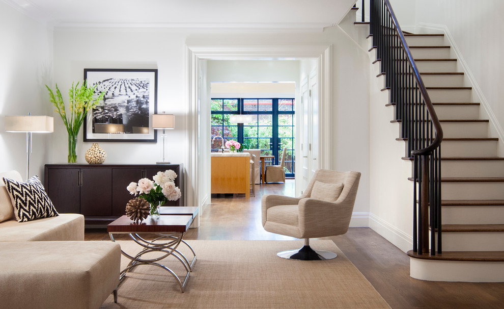 Trendy medium tone wood floor family room photo in New York with white walls, no fireplace and no tv
