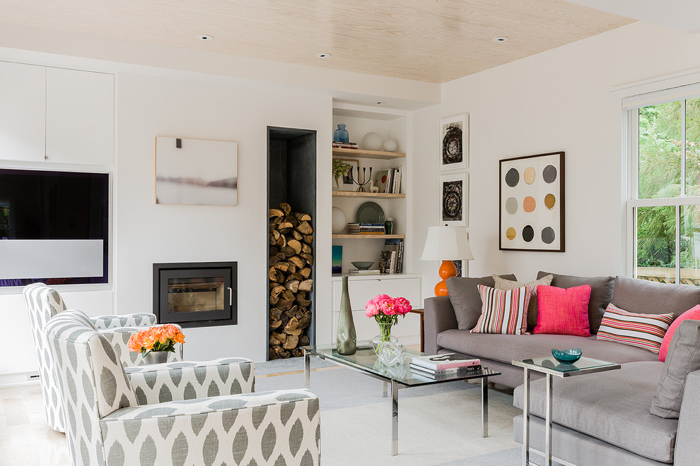 Family room - mid-sized scandinavian open concept family room idea in Boston with white walls, a wall-mounted tv, a plaster fireplace and a ribbon fireplace
