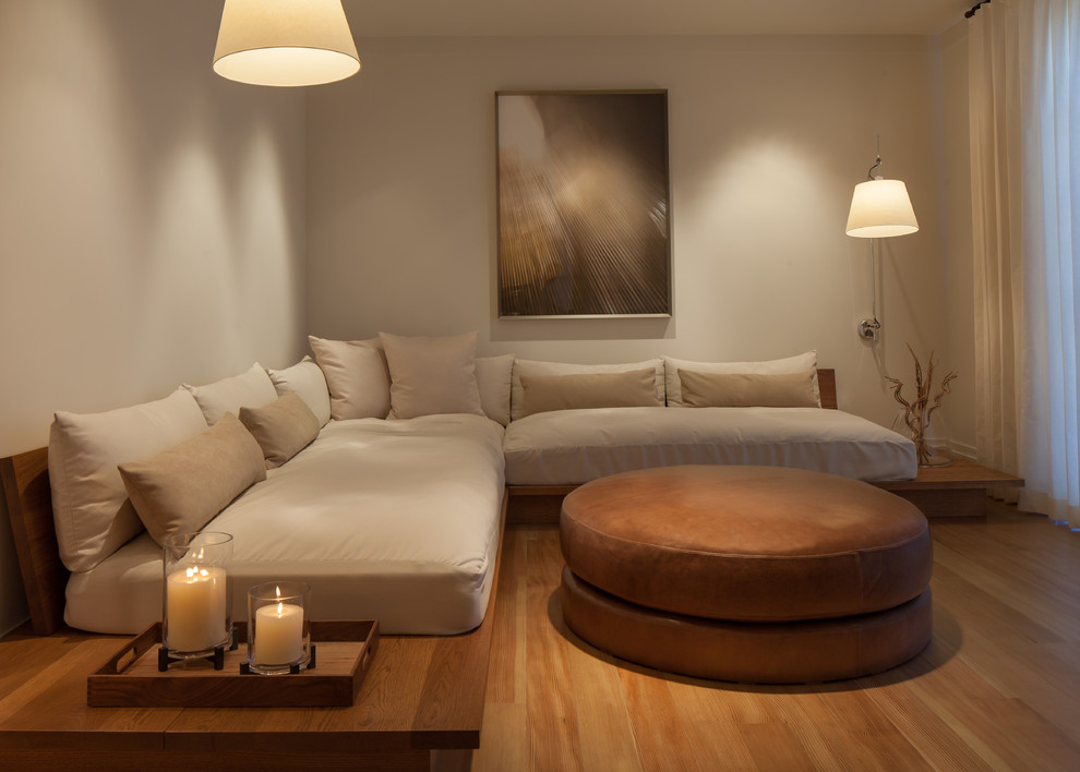 Inspiration for a transitional medium tone wood floor family room remodel in Boise with beige walls and no tv