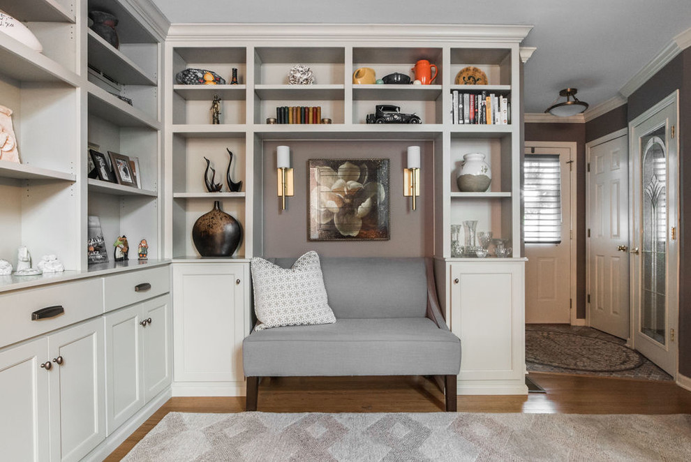Mid-sized transitional open concept medium tone wood floor and beige floor family room library photo in Chicago with gray walls, no fireplace and no tv