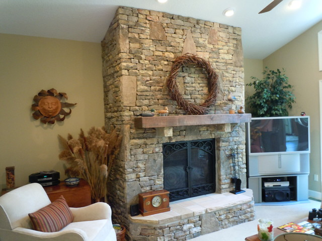 Tn fieldstone stack fireplace traditional family room for Field stone fireplace