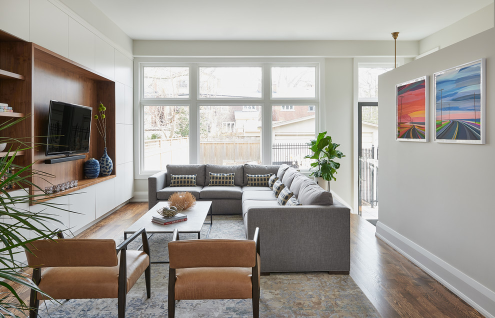 Example of a danish family room design in Toronto