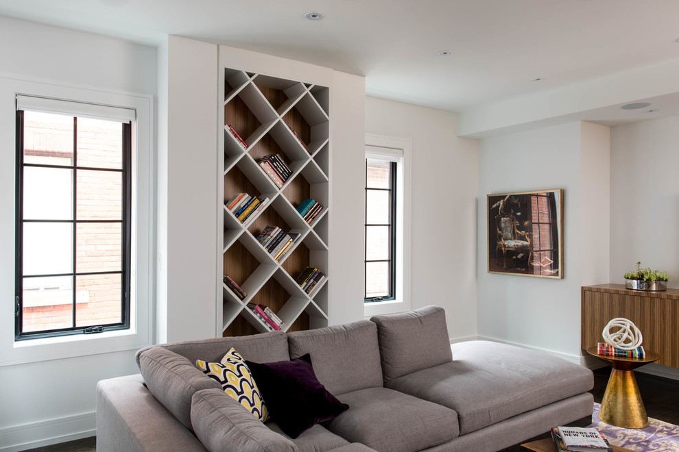 Inspiration for a contemporary dark wood floor family room library remodel in Toronto with white walls